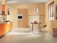 Pomarańczowy kolor kuchni. Słoneczne aranżacje kuchni